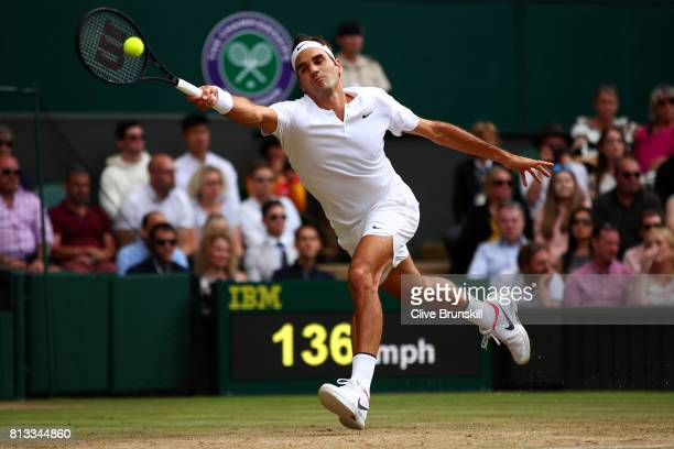 Roger Federer of Switzerland plays a forehand during the Gentlemen's Singles quarter final match against Milos Raonic of Canada on day nine of the...