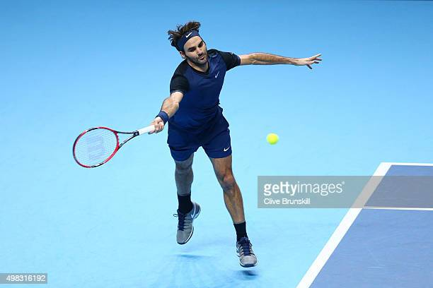 Roger Federer of Switzerland plays a forehand during the men's singles final against Novak Djokovic of Serbia on day eight of the Barclays ATP World...