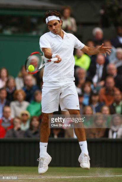 Roger Federer of Switzerland plays a forehand during the men's singles Final match against Rafael Nadal of Spain on day thirteen of the Wimbledon...