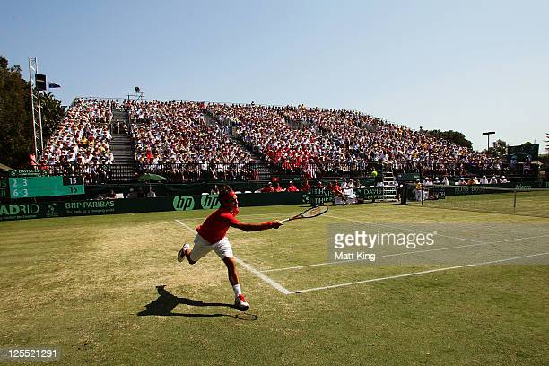 Roger Federer of Switzerland plays a forehand in his Davis Cup World Group Playoff Tie match against Bernard Tomic of Australia at Royal Sydney Golf...