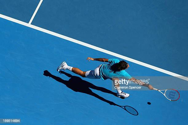Roger Federer of Switzerland plays a forehand in his first round match against Benoit Paire of France during day two of the 2013 Australian Open at...