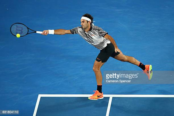 Roger Federer of Switzerland plays a forehand in his first round match against Jurgen Melzer of Austria on day one of the 2017 Australian Open at...