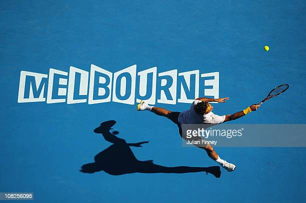 Roger Federer of Switzerland plays a forehand in his fourth round match against Tommy Robredo of Spain during day seven of the 2011 Australian Open...