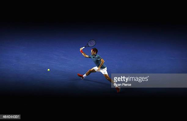 Roger Federer of Switzerland plays a forehand in his fourth round match against JoWilfried Tsonga of France during day eight of the 2014 Australian...