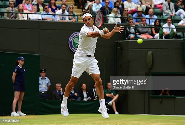 Roger Federer of Switzerland plays a forehand in his Gentlemens Singles Quarter Final match against Gilles Simon of France during day nine of the...