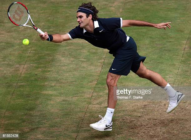 Roger Federer of Switzerland plays a forehand in his match against Marcos Baghdatis form Cyprus during the Gerry Weber Open on June 13 2008 at the...