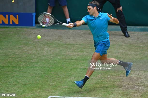 Roger Federer of Switzerland plays a forehand in his match against Matthew Ebden of Australia during day five of the Gerry Weber Open at Gerry Weber...