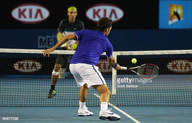 Roger Federer of Switzerland plays a forehand in his men's final match against Rafael Nadal of Spain during day fourteen of the 2009 Australian Open...