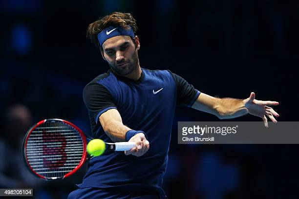 Roger Federer of Switzerland plays a forehand in his men's semi final against Stanislas Wawrinka of Switzerland on day seven of the Barclays ATP...