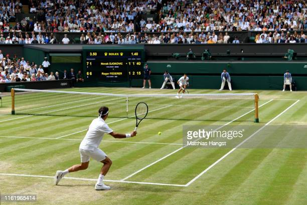 Roger Federer of Switzerland plays a forehand in his Men's Singles final against Novak Djokovic of Serbia during Day thirteen of The Championships -...