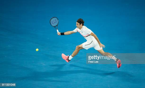 Roger Federer of Switzerland plays a forehand in his men's singles final match against Marin Cilic of Croatia on day 14 of the 2018 Australian Open...
