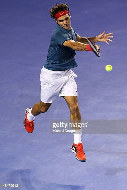 Roger Federer of Switzerland plays a forehand in his semifinal match against Rafael Nadal of Spain during day 12 of the 2014 Australian Open at...