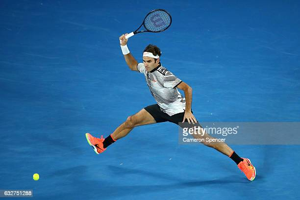 Roger Federer of Switzerland plays a forehand in his semifinal match against Stan Wawrinka of Switzerland on day 11 of the 2017 Australian Open at...