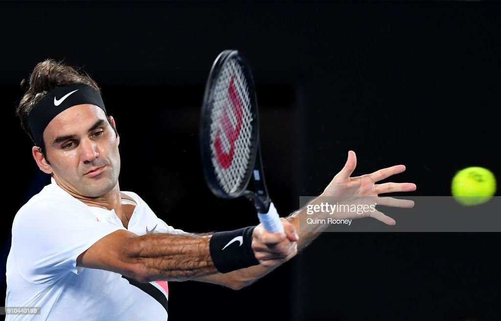 Roger Federer of Switzerland plays a forehand in his semi-final match against Hyeon Chung of South Korea on day 12 of the 2018 Australian Open at Melbourne Park on January 26, 2018 in Melbourne, Australia.