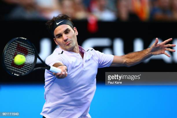 Roger Federer of Switzerland plays a forehand in his singles match against Jack Sock of the United States on day six of the 2018 Hopman Cup at Perth...