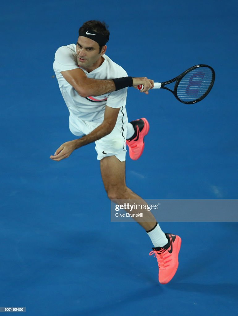 Roger Federer of Switzerland plays a forehand in his third round match against Richard Gasquet of France on day six of the 2018 Australian Open at Melbourne Park on January 20, 2018 in Melbourne, Australia.