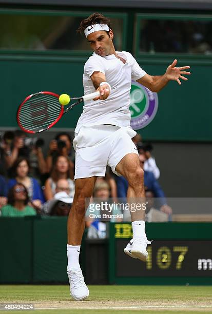 Roger Federer of Switzerland plays a forehand in the Final Of The Gentlemen's Singles against Novak Djokovic of Serbia on day thirteen of the...