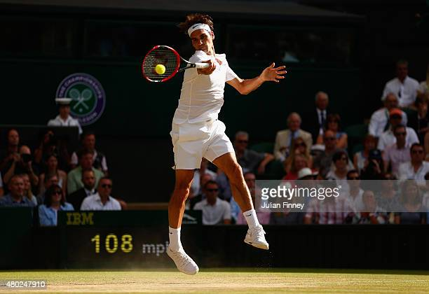 Roger Federer of Switzerland plays a forehand in the Gentlemens Singles Semi Final match against Andy Murray of Great Britain during day eleven of...