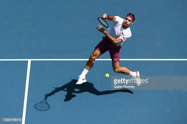 Roger Federer of Switzerland plays a forehand smash during his Men's Singles Quarterfinal match against Tennys Sandgren of the United States on day...