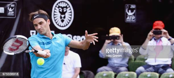 Roger Federer of Switzerland plays a forehand to Guido Pella of Argentina during day 5 of the Mercedes Cup at Tennisclub Weissenhof on June 15, 2018...