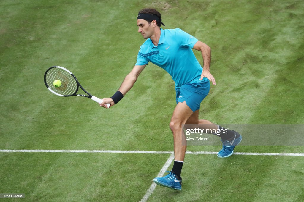 Roger Federer of Switzerland plays a forehand to Mischa Zverev of Germany during day 3 of the Mercedes Cup at Tennisclub Weissenhof on June 13, 2018 in Stuttgart, Germany. Roger Federer debuts his new Wilson Pro Staff RF 97 Autograph racket at the 2018 Mercedes Cup in Stuttgart. The white and black design of the racket was inspired by the classic tuxedo, or dinner suit, and Federer's timeless and elegant sense of style.