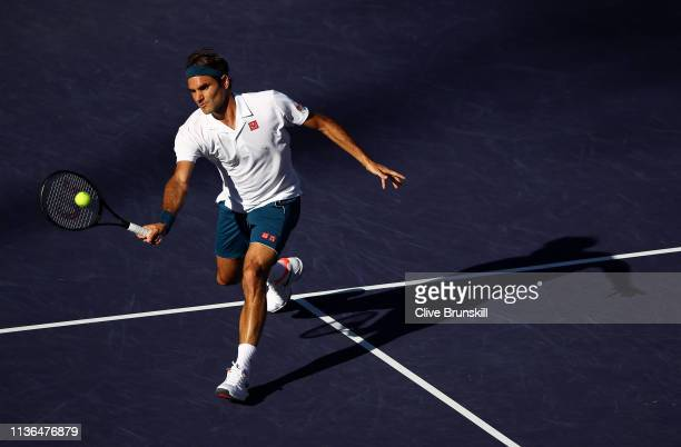 Roger Federer of Switzerland plays a forehand volley against Dominic Thiem of Austria during their men's singles final on day fourteen of the BNP...