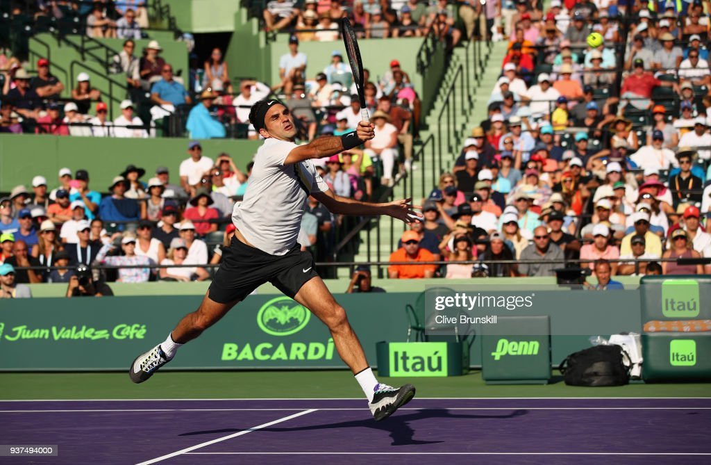 Roger Federer of Switzerland plays a forehand volley against Thanasi Kokkinakis of Australia in their second round match during the Miami Open Presented by Itau at Crandon Park Tennis Center on March 24, 2018 in Key Biscayne, Florida.