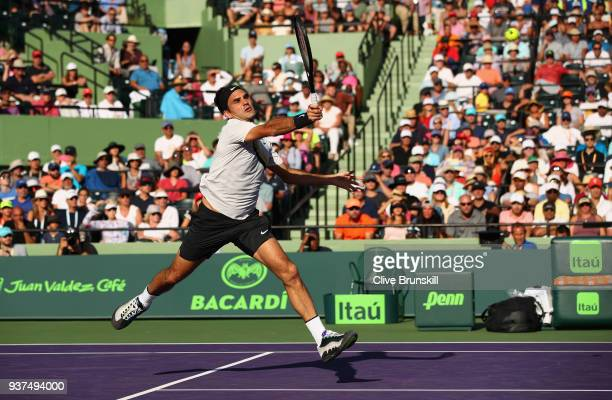 Roger Federer of Switzerland plays a forehand volley against Thanasi Kokkinakis of Australia in their second round match during the Miami Open...