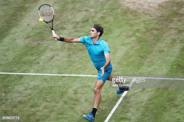 Roger Federer of Switzerland plays a forehand volley to Milos Raonic of Canada during the final match on day 7 of the Mercedes Cup at Tennisclub...