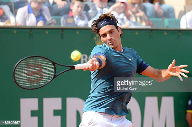 Roger Federer of Switzerland plays a shot against Novak Djokovic of Serbia during their semi final match on day seven of the ATP Monte Carlo Masters...