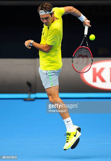 Roger Federer of Switzerland plays a shot behind his back during a practice session ahead of the 2015 Australian Open at Melbourne Park on January 15...