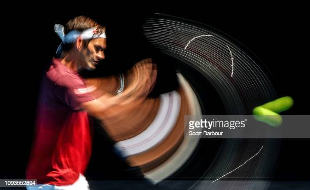 Roger Federer of Switzerland plays a shot during a practice session ahead of the 2019 Australian Open at Melbourne Park on January 13 2019 in...