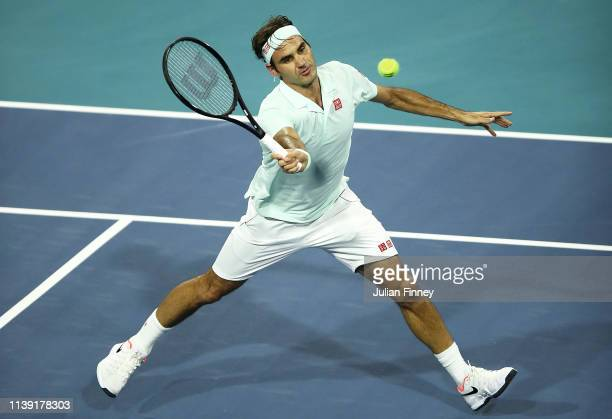 Roger Federer of Switzerland plays a volley against Denis Shapovalov of Canada during day twelve of the Miami Open tennis on March 29, 2019 in Miami...