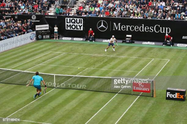 Roger Federer of Switzerland plays a volley to Mischa Zverev of Germany during day 3 of the Mercedes Cup at Tennisclub Weissenhof on June 13 2018 in...
