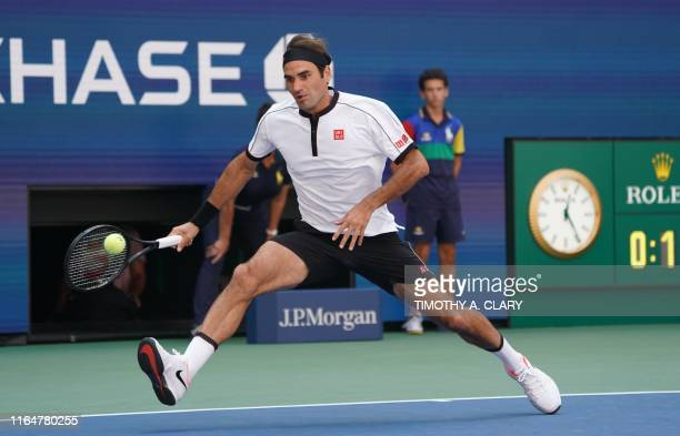 Roger Federer of Switzerland plays against Daniel Evans of Great Britain during their Round Three Men's Singles match at the 2019 US Open at the USTA...