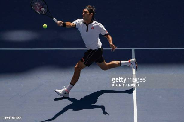Roger Federer of Switzerland plays against Daniel Evans of Great Britian during their Round Three Men's Singles match at the 2019 US Open at the USTA...