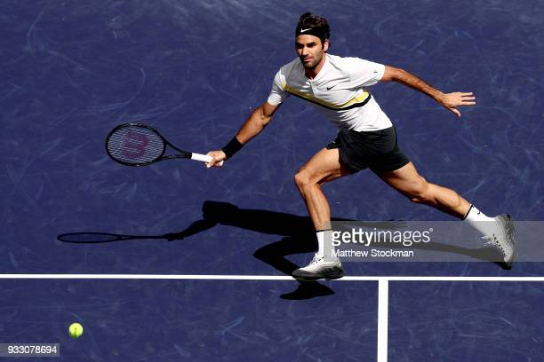 Roger Federer of Switzerland plays Borna Coric of Croatia during the semifinals of the BNP Paribas Open at the Indian Wells Tennis Garden on March...