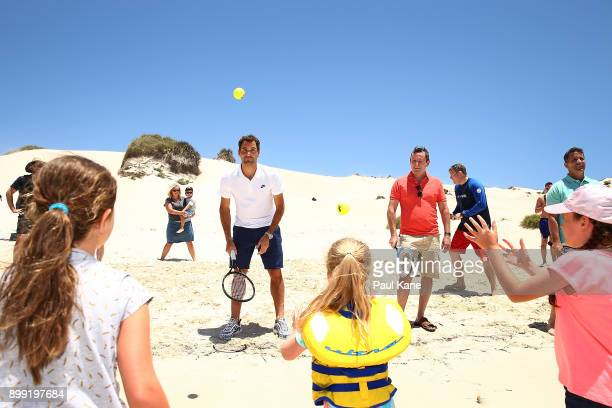 Roger Federer of Switzerland plays some tennis on the beach with children at Rottnest Island ahead of the 2018 Hopman Cup on December 28 2017 in...