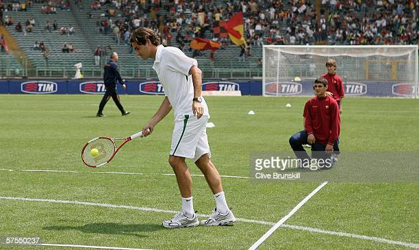 Roger Federer of Switzerland plays tennis at the Olympic stadium prior to the soccer match between Roma and Treviso before the ATP Masters Series at...