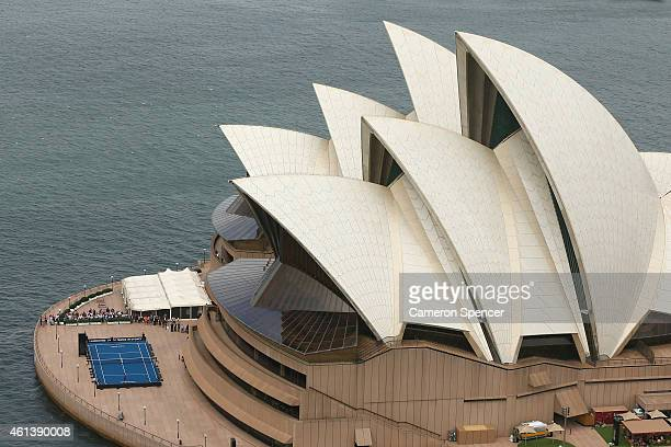 Roger Federer of Switzerland plays tennis with Lleyton Hewitt of Australia on the forecourt of the Sydney Opera House ahead of their Fast 4...