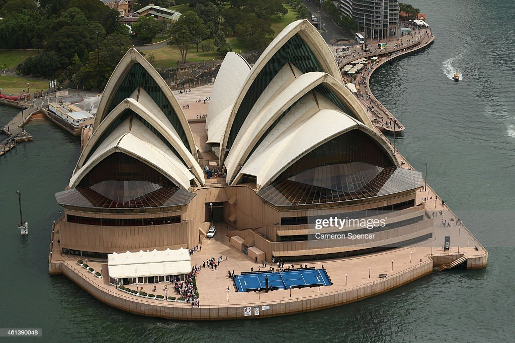 Roger Federer of Switzerland plays tennis with Lleyton Hewitt of Australia on the forecourt of the Sydney Opera House ahead of their Fast 4 Exhibition match on January 12, 2015 in Sydney, Australia.
