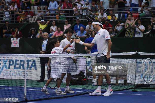 Roger Federer of Switzerland plays with ball boys during an exhibition game between Alexander Zverev and Roger Federer at Arena Parque Roca on...