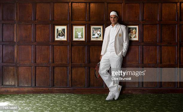 Roger Federer of Switzerland poses for a portrait wearing the luxury 'heritage' style bespoke kit designed for him by Nike on June 19 2007 in...