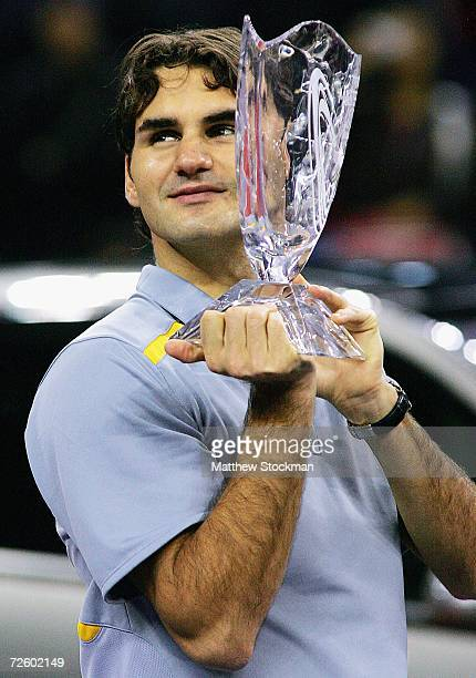 Roger Federer of Switzerland poses for photographers after defeating James Blake during the final of the Tennis Masters Cup Shanghai November 19 2006...