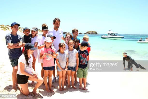 Roger Federer of Switzerland poses for photos on the beach at Rottnest Island ahead of the 2018 Hopman Cup on December 28 2017 in Perth Australia