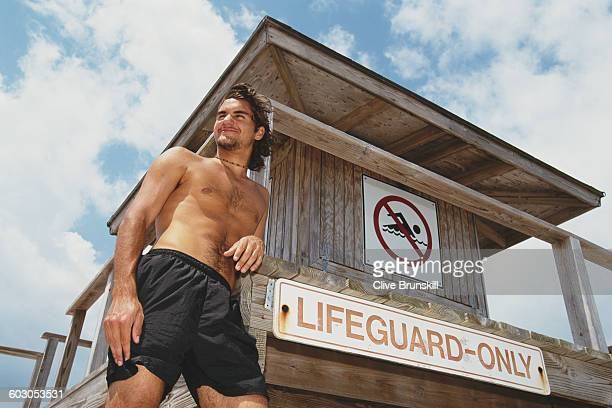Roger Federer of Switzerland poses next to a Lifeguard post on the beach at the ATP Ericsson Open Tennis Championship on 27 March 2000 in Key...
