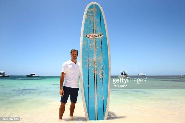 Roger Federer of Switzerland poses with a stand up paddle board at Rottnest Island ahead of the 2018 Hopman Cup on December 28 2017 in Perth Australia