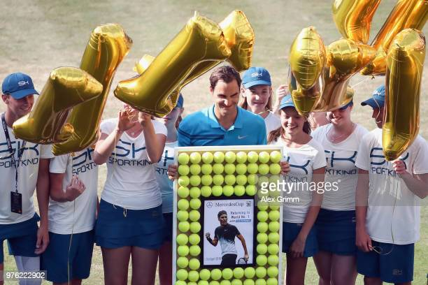 Roger Federer of Switzerland poses with ball kids after defeating Nick Kyrgios of Australia and returning to the top position in the ATP global...