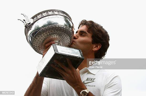 Roger Federer of Switzerland poses with his French Open winners trophy at the Arc de Triomphe on June 8 2009 in Paris France
