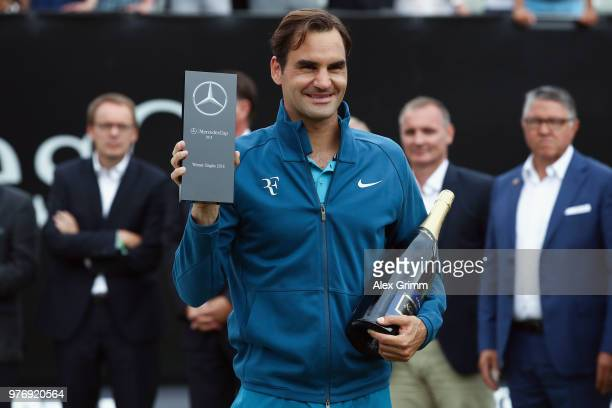 Roger Federer of Switzerland poses with his the trophy after defeating Milos Raonic of Canada in the final match on day 7 of the Mercedes Cup at...